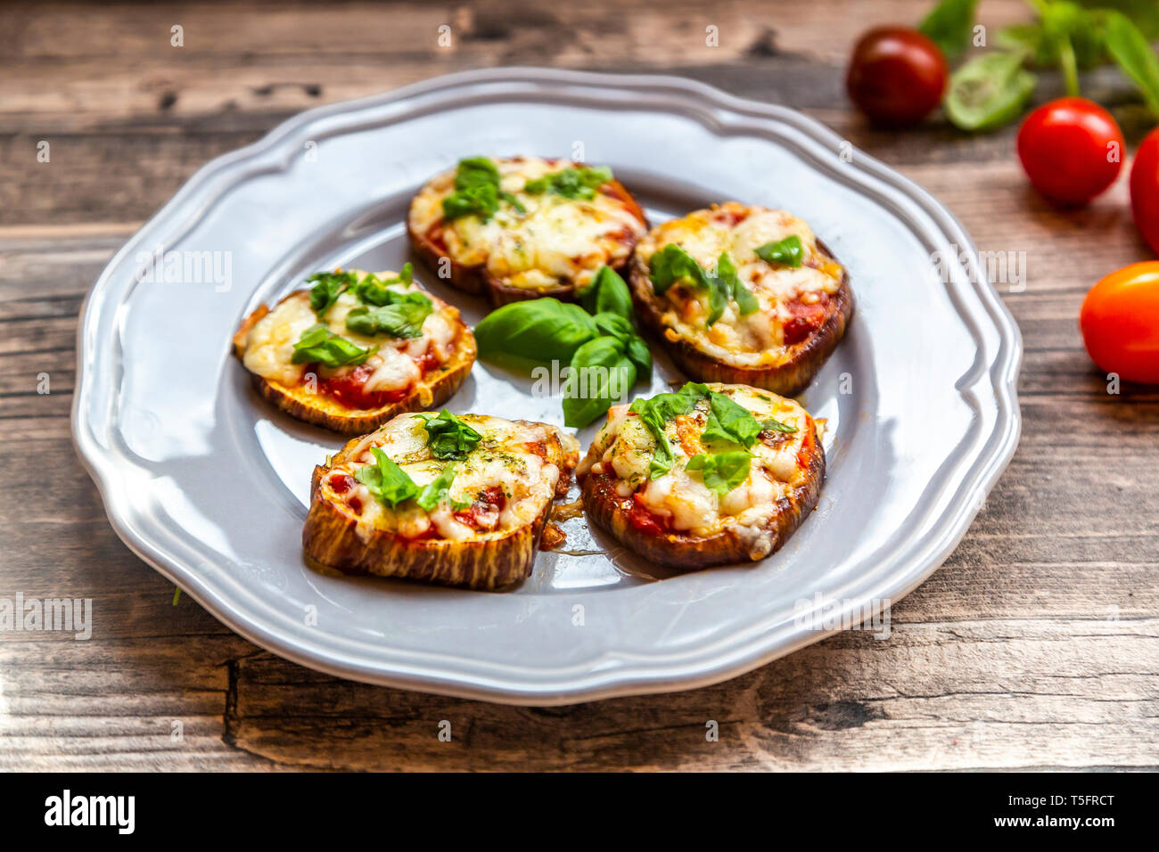 Aubergine pizza, aubergine slices with tomato sauce and cheese, gratinated, low carb - Stock Image