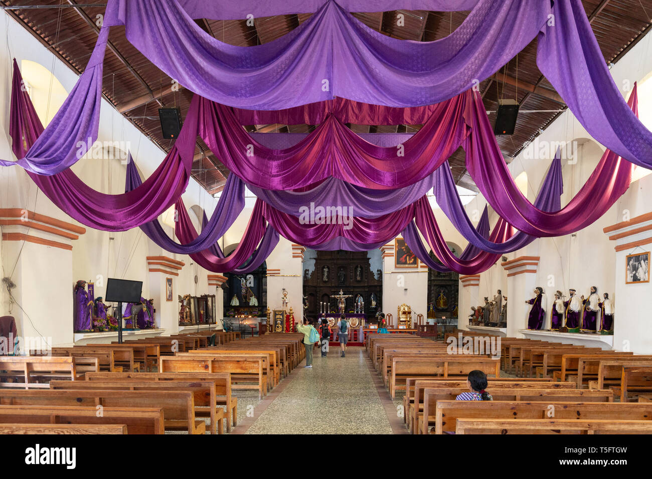 Colourful Nave in Holy Week, the interior of St James the Apostle Church, Santiago Atitlan , Guatemala, Central America - Stock Image