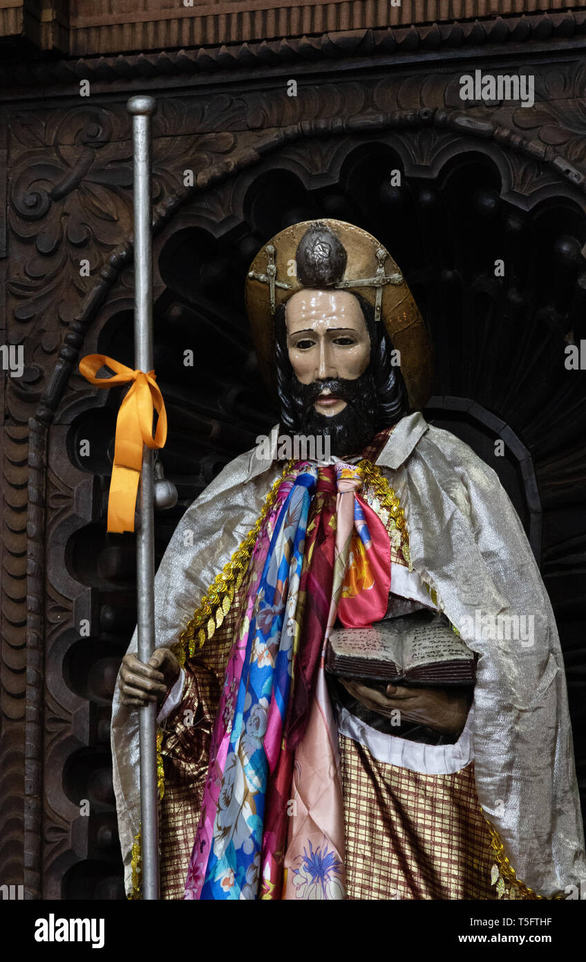 Wooden religious figures painted and costumed in St James the Apostle Church, Santiago Atitlan town, Guatemala, Central America - Stock Image