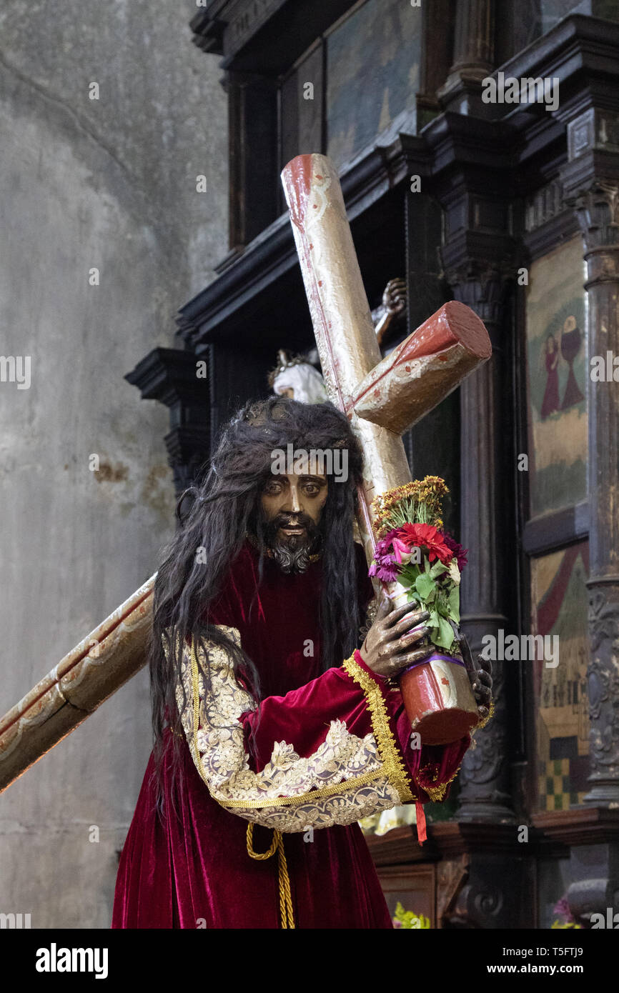 Wooden statue of Jesus carrying cross, in St James the Apostle Church, Santiago Atitlan town, Guatemala, Central America - Stock Image