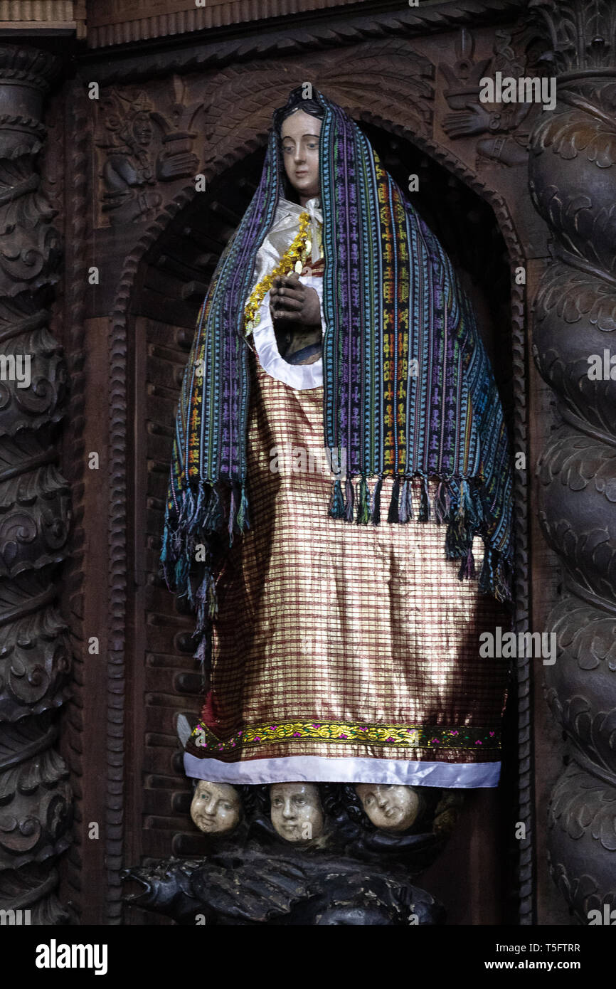 Wooden religious female figure painted and costumed in St James the Apostle Church, Santiago Atitlan town, Guatemala, Central America - Stock Image