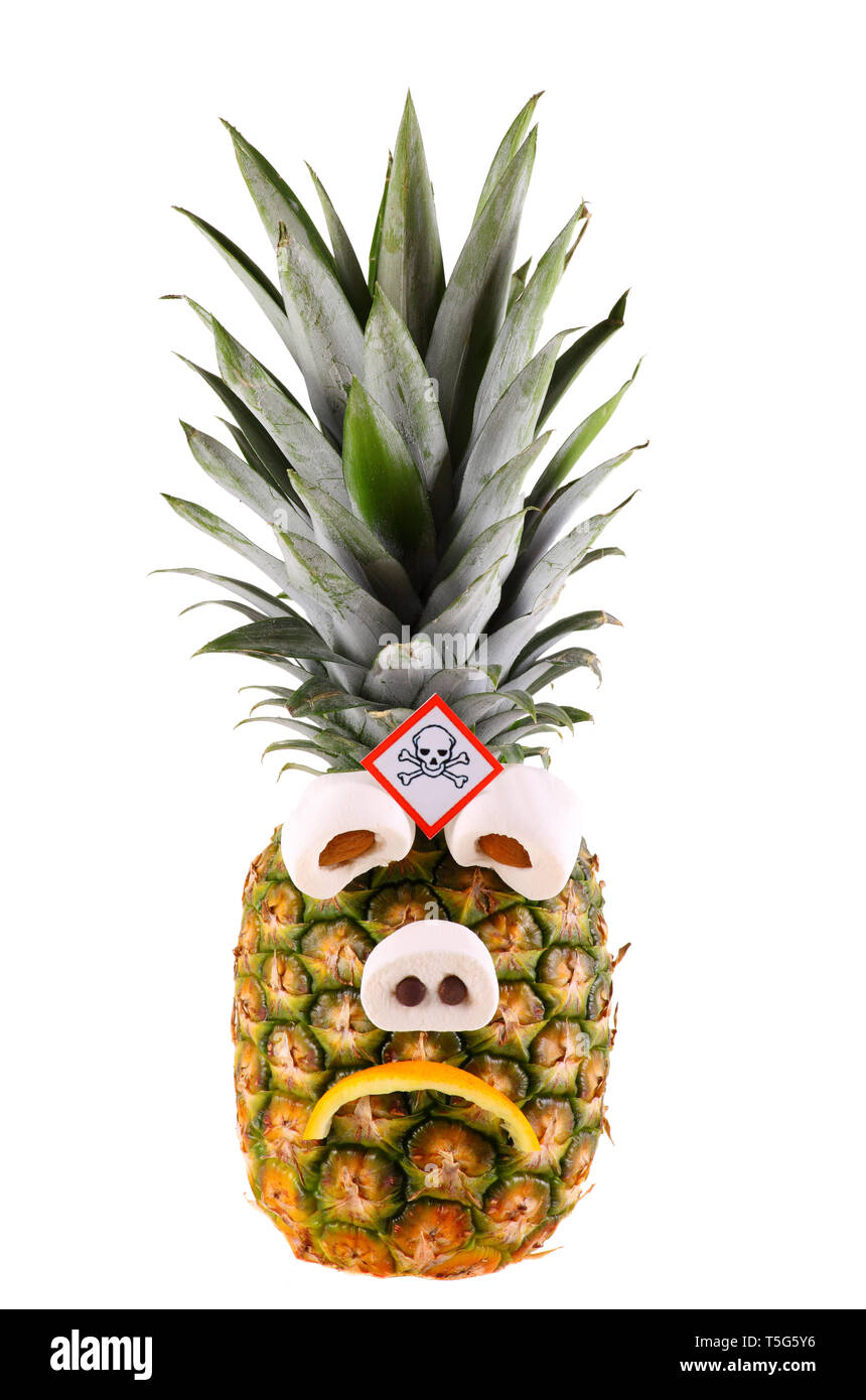 Sad pineapple with poison symbol - isolated on a white background. - Stock Image