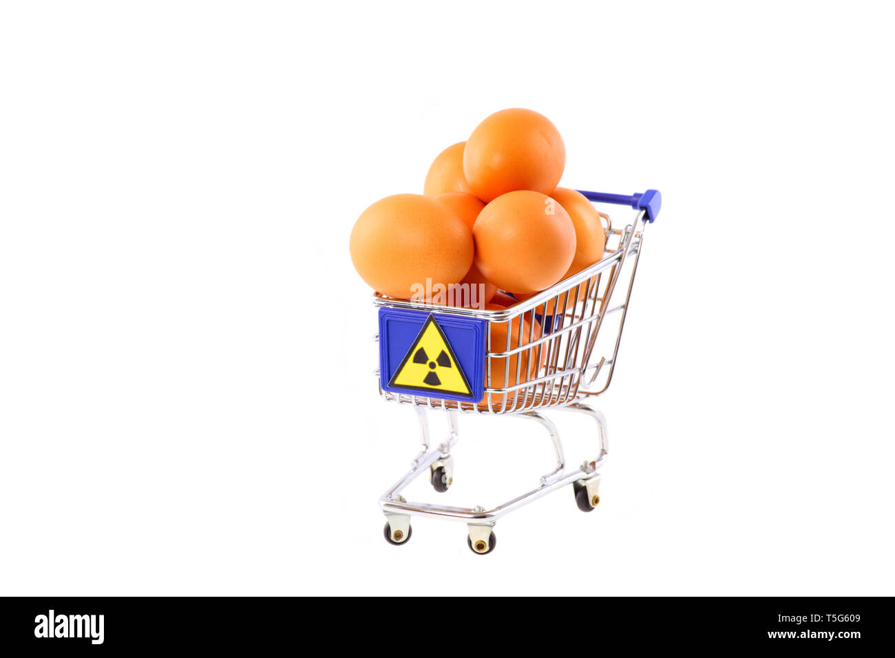 Radioactive contaminated eggs in a shopping cart - isolated - Stock Image