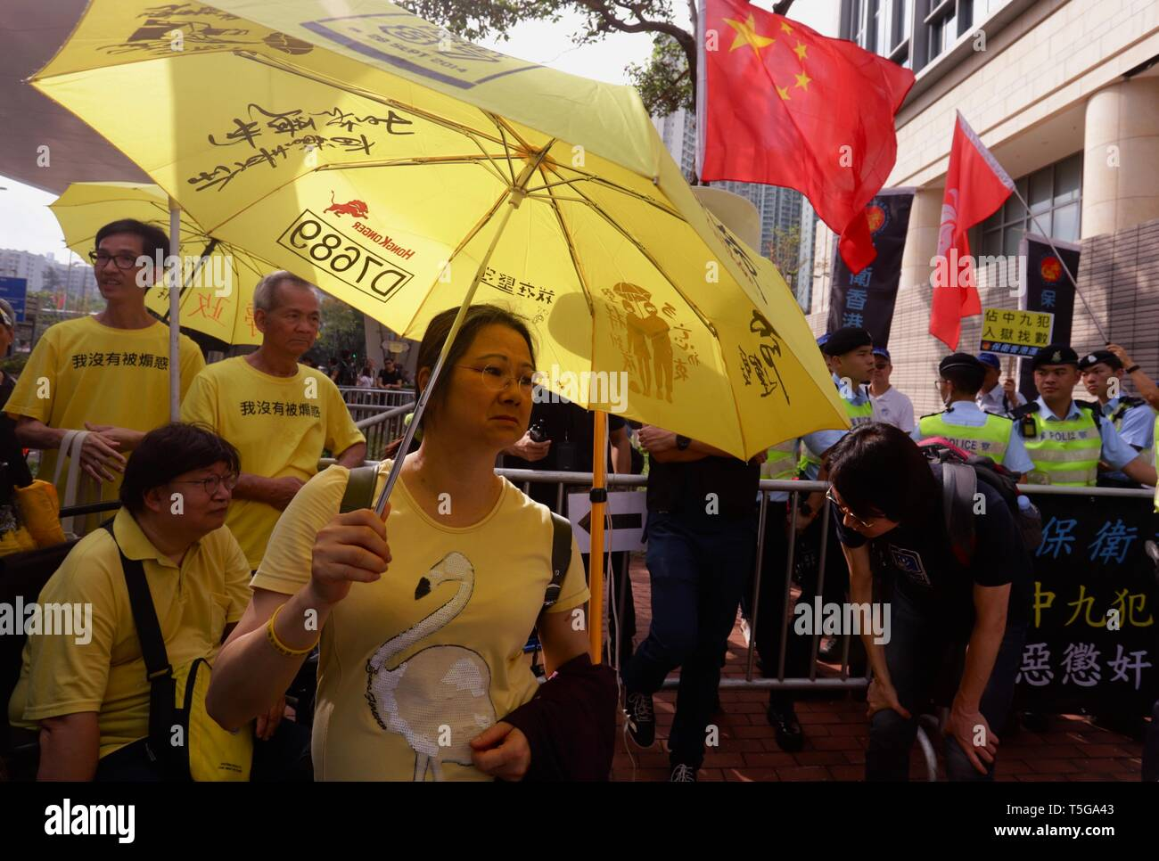 Hong Kong. 24th Apr, 2019. Supporters of the 2014 Umbrella Movement defiantly display their symbol, YELLOW UMBRELLA in front of the pro-China supporters outside West Kowloon Court this morning.April-24, 2019 Hong Kong.ZUMA/Liau Chung-ren Credit: Liau Chung-ren/ZUMA Wire/Alamy Live News - Stock Image
