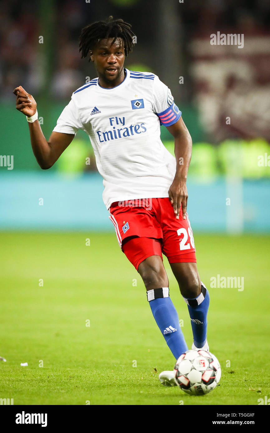 Hamburg, Germany. 23rd Apr, 2019. Soccer: DFB Cup, Hamburger SV - RB Leipzig, semi-final in Volksparkstadion. Hamburg's Gideon Jung plays the ball. Credit: Christian Charisius/dpa/Alamy Live News - Stock Image