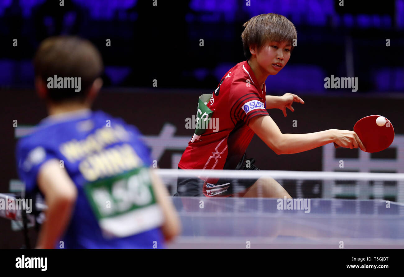 (190425) -- BUDAPEST, April 25, 2019 (Xinhua) -- Hitomi Sato of Japan competes during the women's singles round of 16 match against Wang Manyu of China at 2019 ITTF World Table Tennis Championships in Budapest, Hungary, April 24, 2019. (Xinhua/Han Yan) Stock Photo