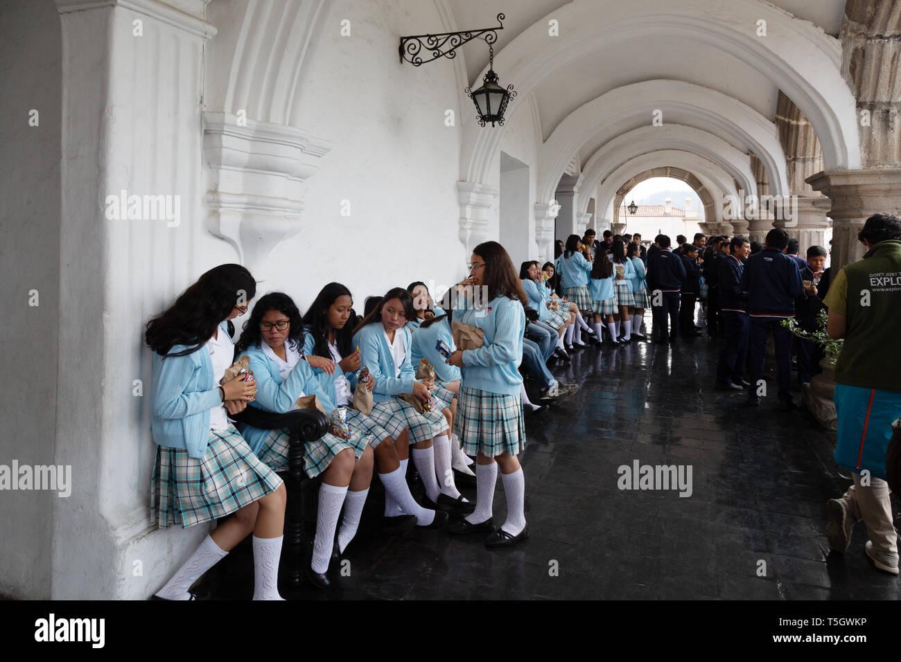 Guatemala schoolchildren in the Plaza Mayor, Antigua UNESCO World heritage site, Antigua Guatemala Central America - Stock Image