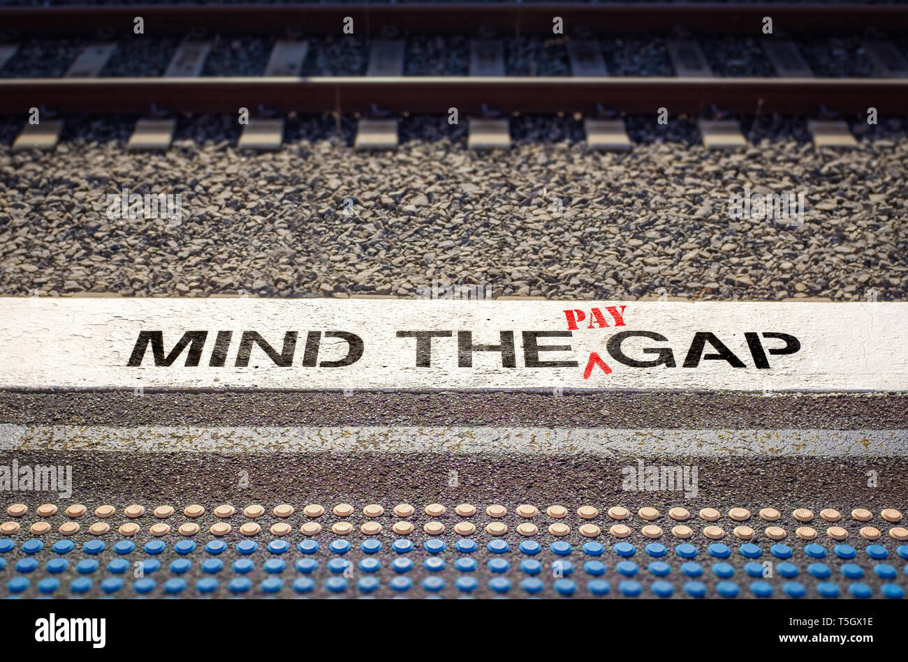 Pay gap, mind the pay gap graffiti inequality in pay between employees and bosses pay concept – image - Stock Image