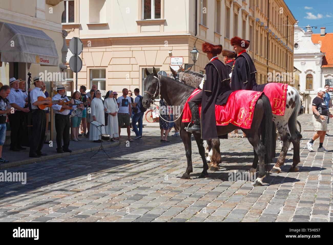 Cravat Regiment Guard of Honor, Kravat, men, horseback, Croat uniforms, St. Marks Square, ceremonial, antique black costumes, musicians playing, St. M - Stock Image
