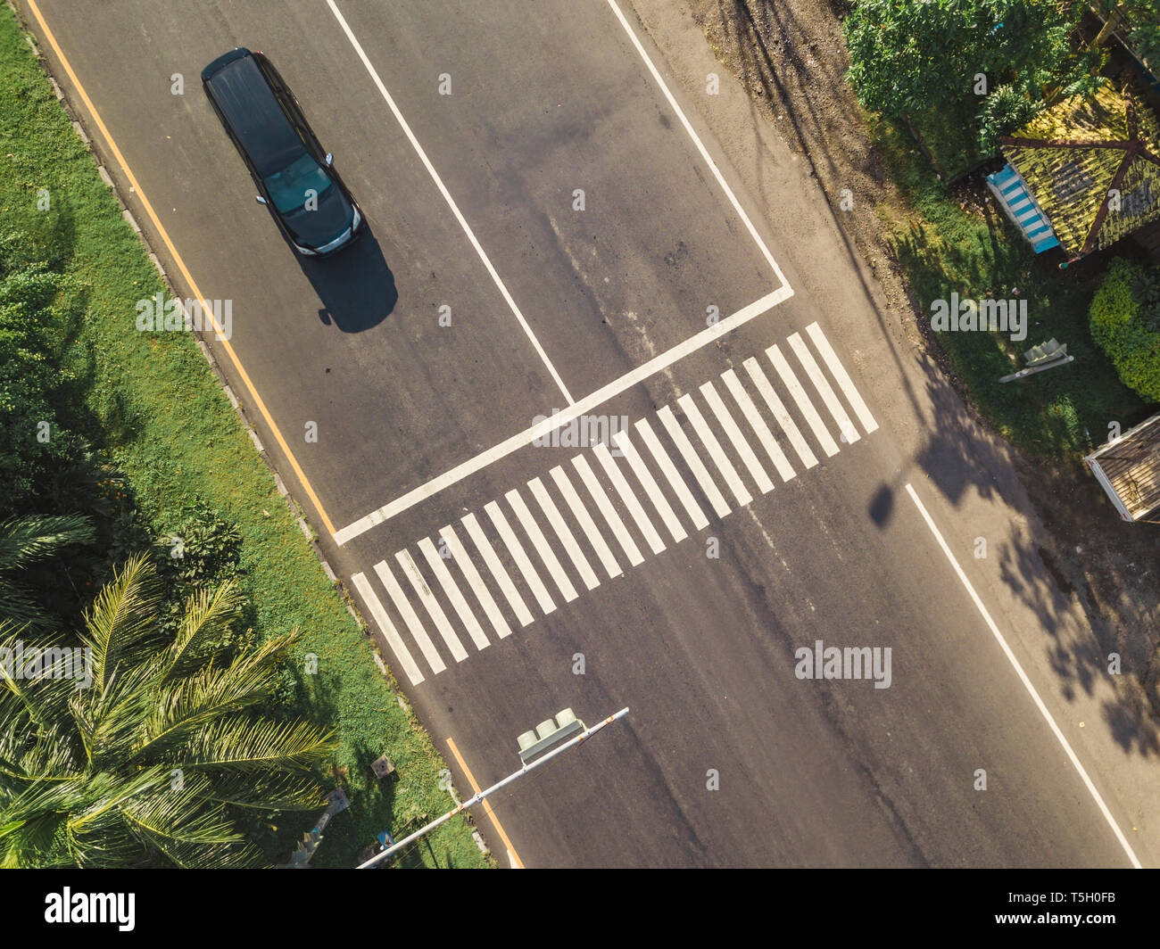Indonesia, Bali, Sanur, Aerial view of car at zebra crossing on the road Stock Photo