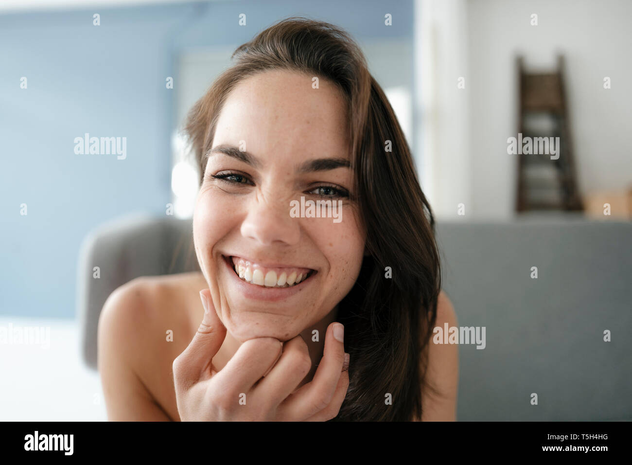 Portrait of a pretty woman with bare shoulders, smiling - Stock Image