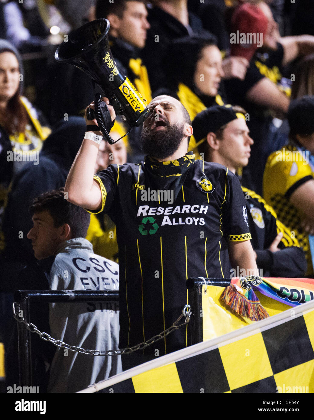 April 24, 2019: A Columbus Crew fan cheers his team on against DC United in their game in Columbus, Ohio, USA. Brent Clark/Alamy Live News - Stock Image