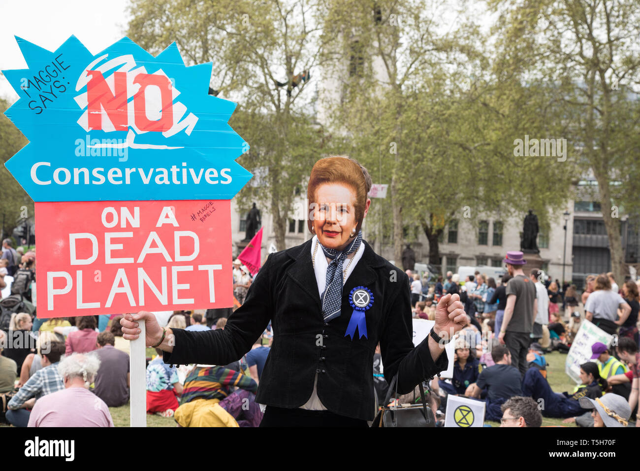 London, UK. 23 April 2019. Environmental campaigners Extinction Rebellion march from marble Arch to Parliament Square, Westminster London. The members - Stock Image