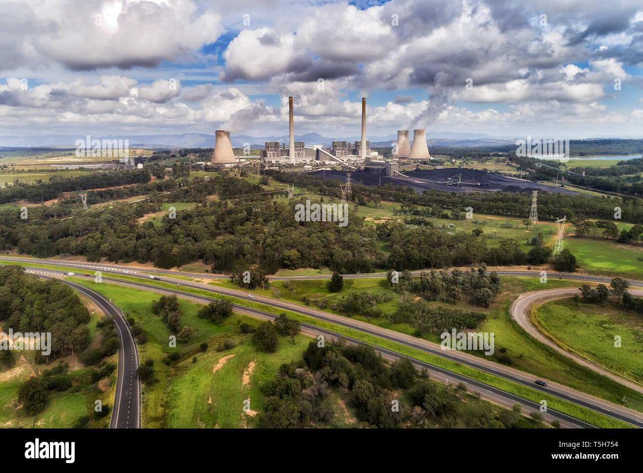 Bayswater power plant in Australian Upper Hunter Valley generating electricity from fossil fuel black coal emitting carbon dioxide into atmosphere on  Stock Photo