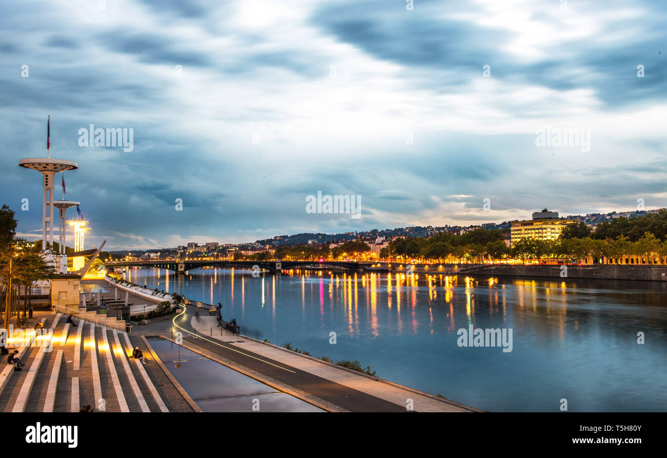 Giant flagpoles over a public swimming pool on riverside of Rhone river in Lyon, France - Stock Image
