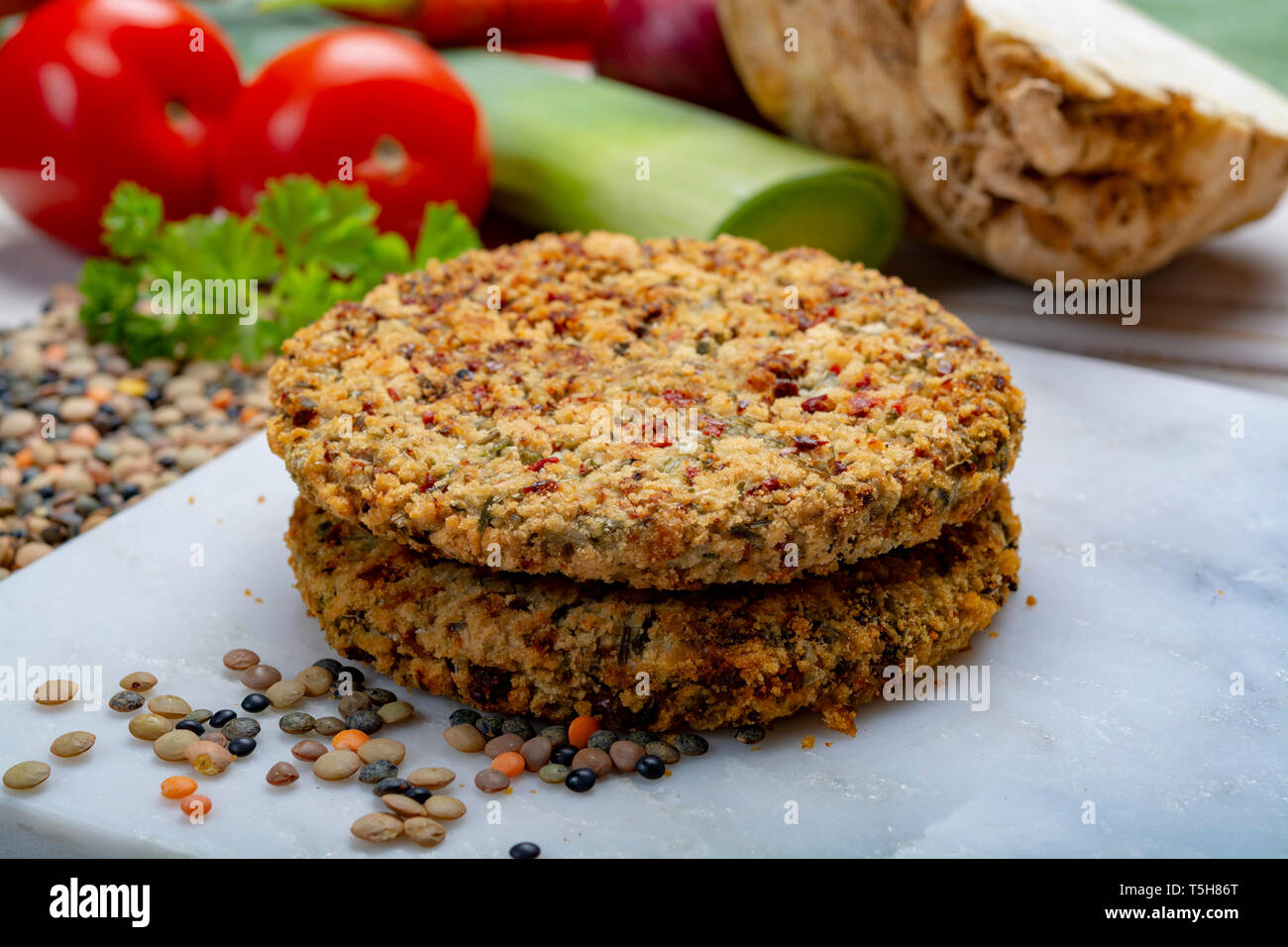 Tasty vegetarian food, raw burgers made from lentils legumes with vegetables ready for cooking, good for vegans Stock Photo