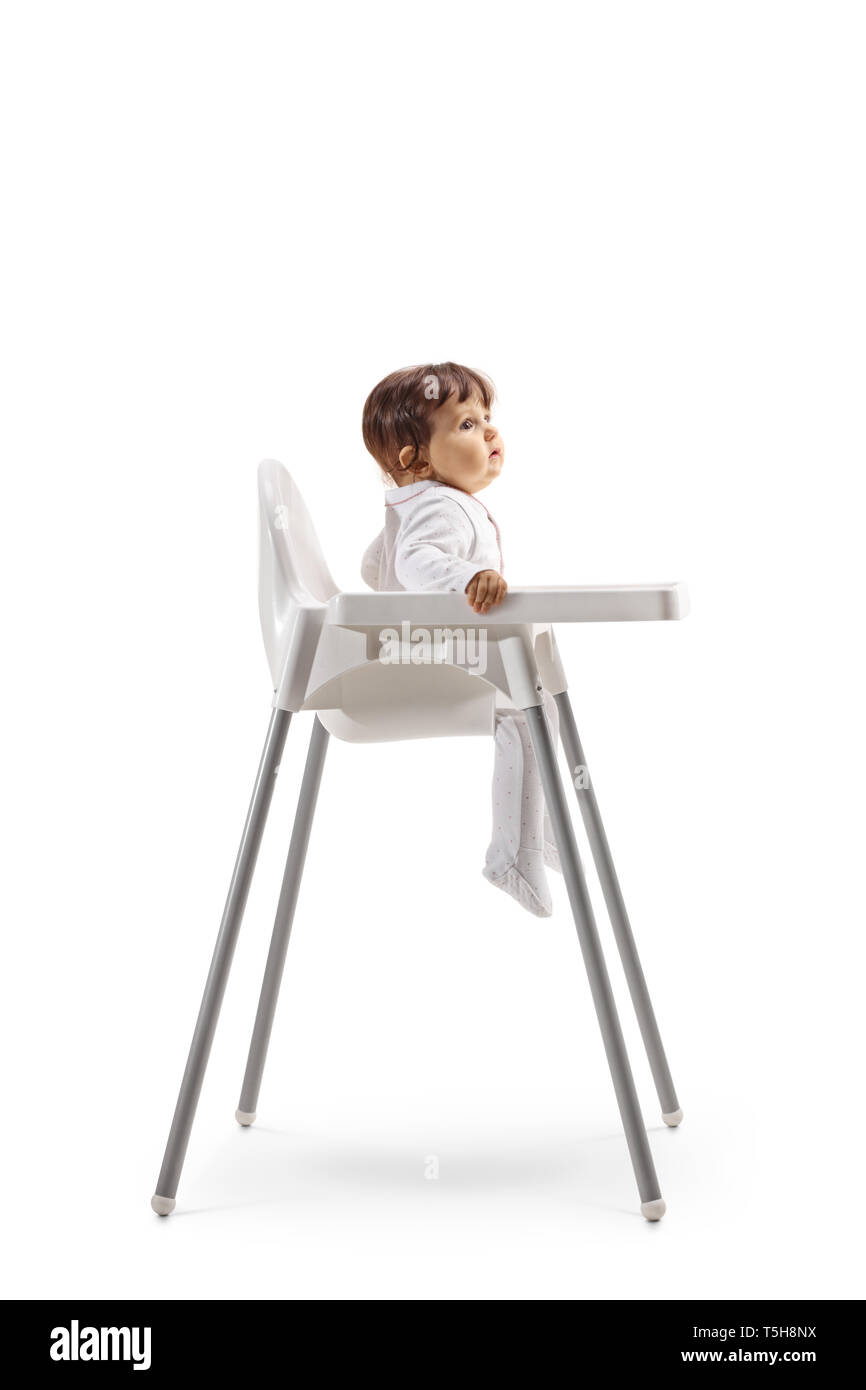 Full length profile shot of a baby sitting in a baby chair isolated on white background - Stock Image