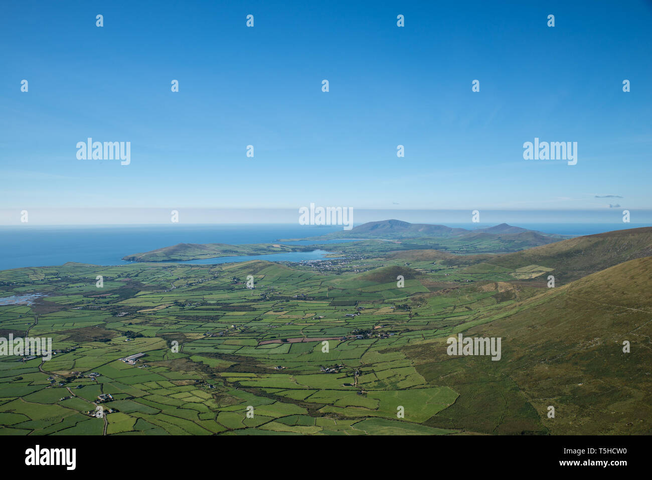 Dingle bay and the village of Dingle (2,000 inhabitants) on the Dingle peninsula in West Kerry, Republic of Ireland. - Stock Image