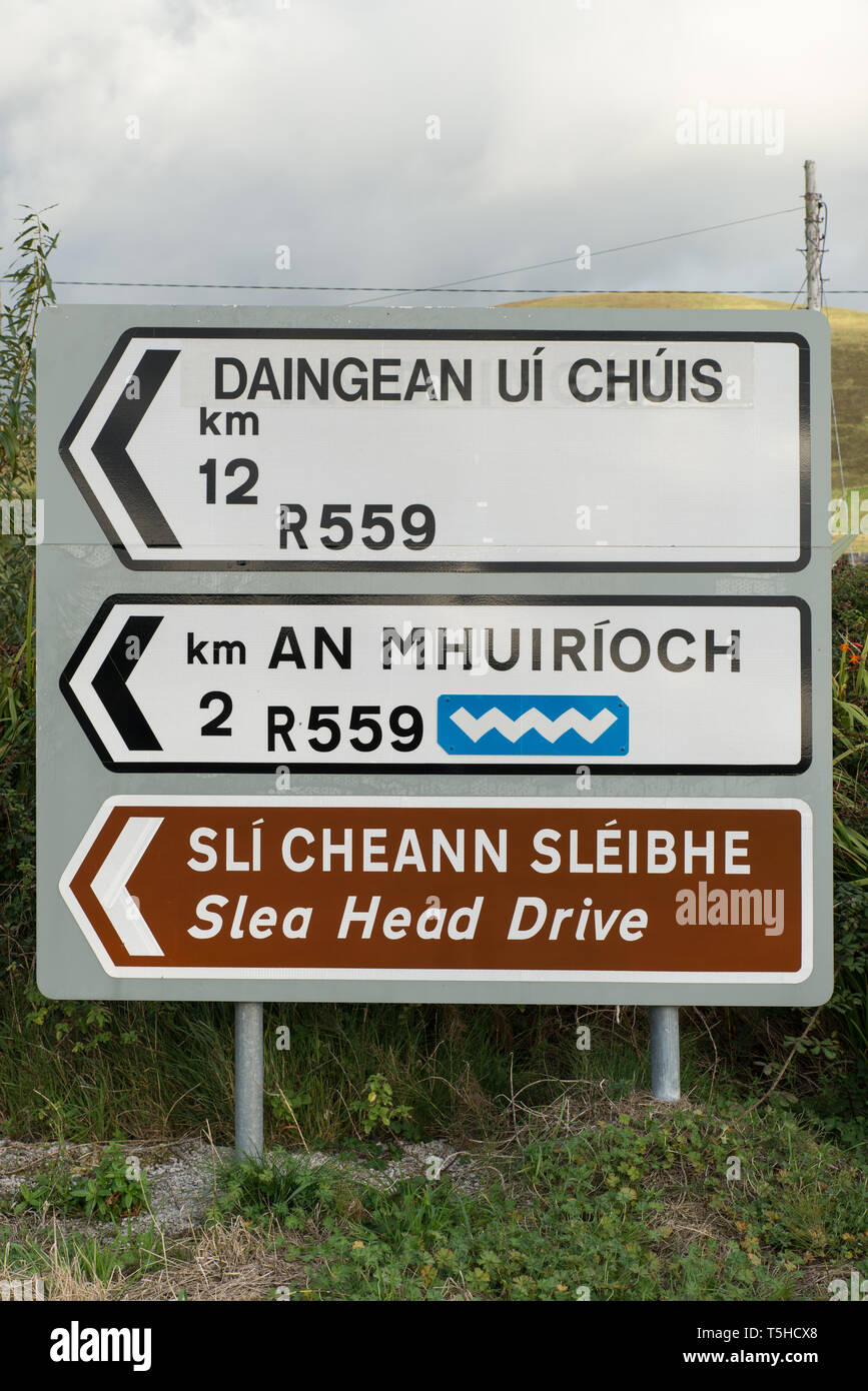 Road signs in Gaelic language, Co. Kerry, Ireland. In some parts of Ireland areas called Gaeltacht, Gaelic is recognised as a primary language. - Stock Image