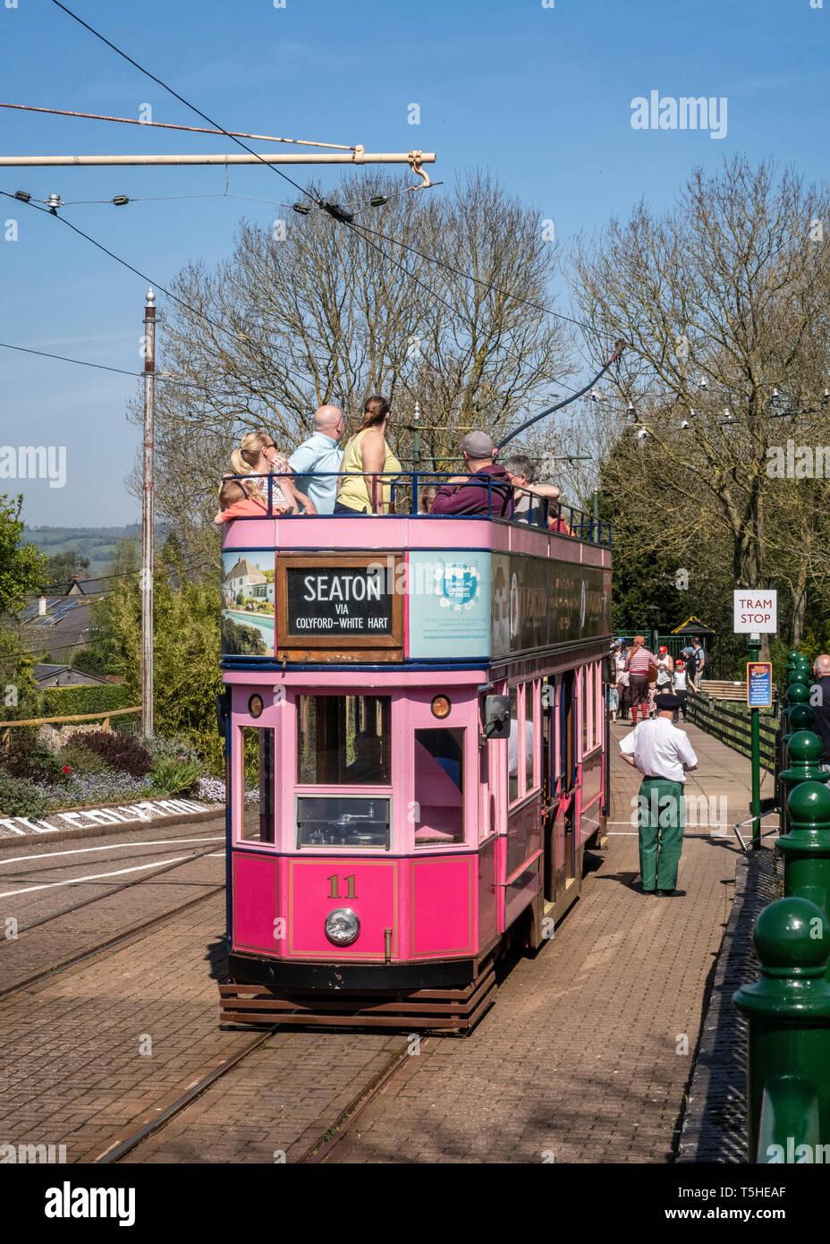 People aboard the Seaton tramway at Colyton Station, Devon, UK Stock Photo