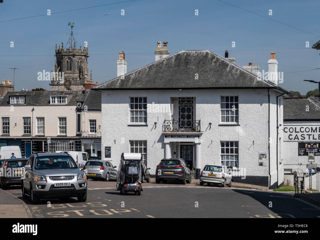 View looking through the village to the church of St Andrew, Colyton, Devon. UK Stock Photo
