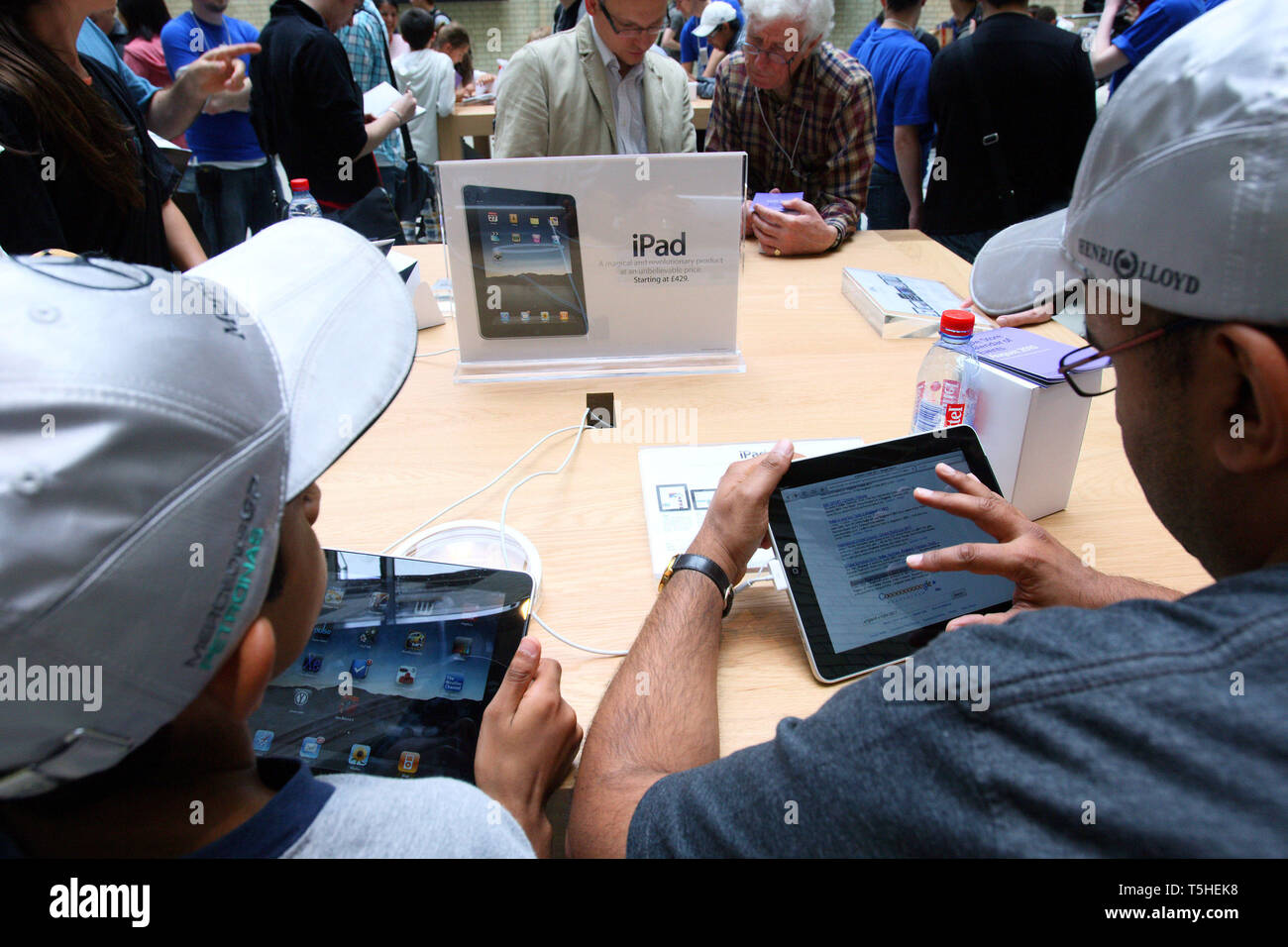 using  iPad at Apples Covent Garden store in London. 7 August 2010. - Stock Image