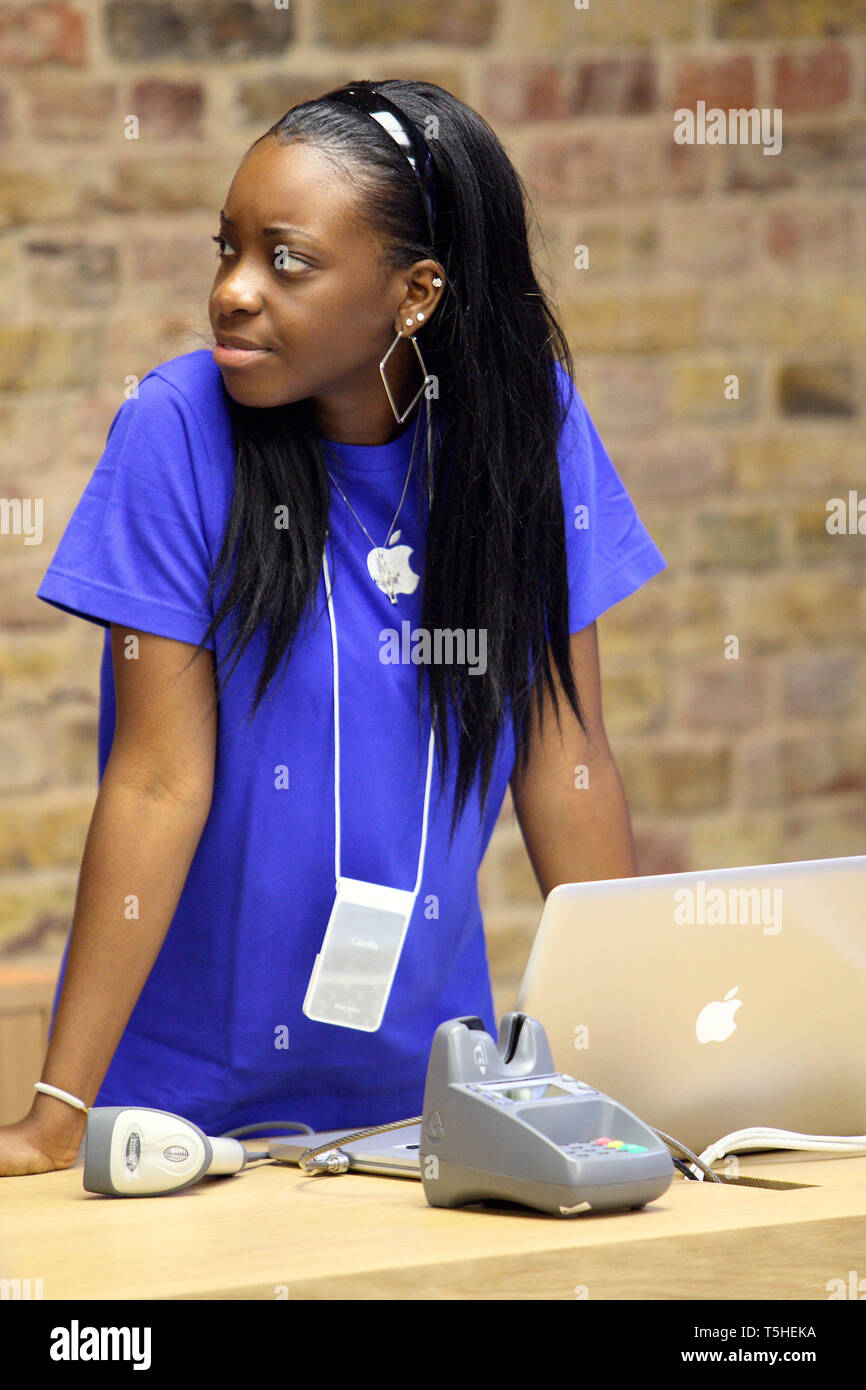 Staff at the checkout at Apples Covent Garden store in London. 7 August 2010. - Stock Image
