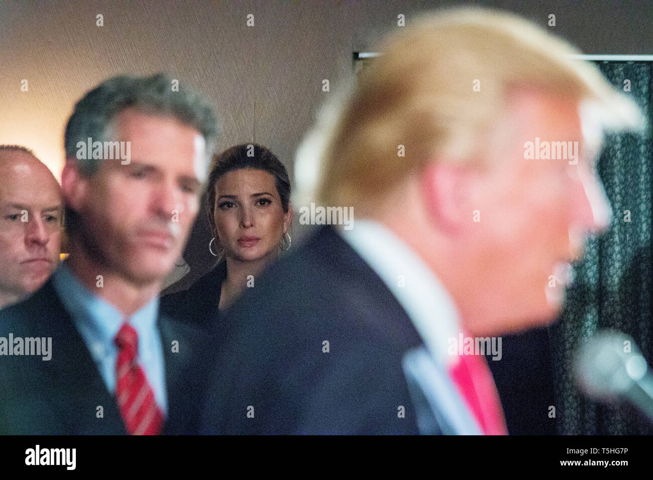 Ivanka Trump listens in the background as her father, the republican Presidential candidate Donald J. Trump hosts a press conference in Milford, NH, where he announced the endorsement from former Massachussetts Senator Scott Brown (left). Stock Photo