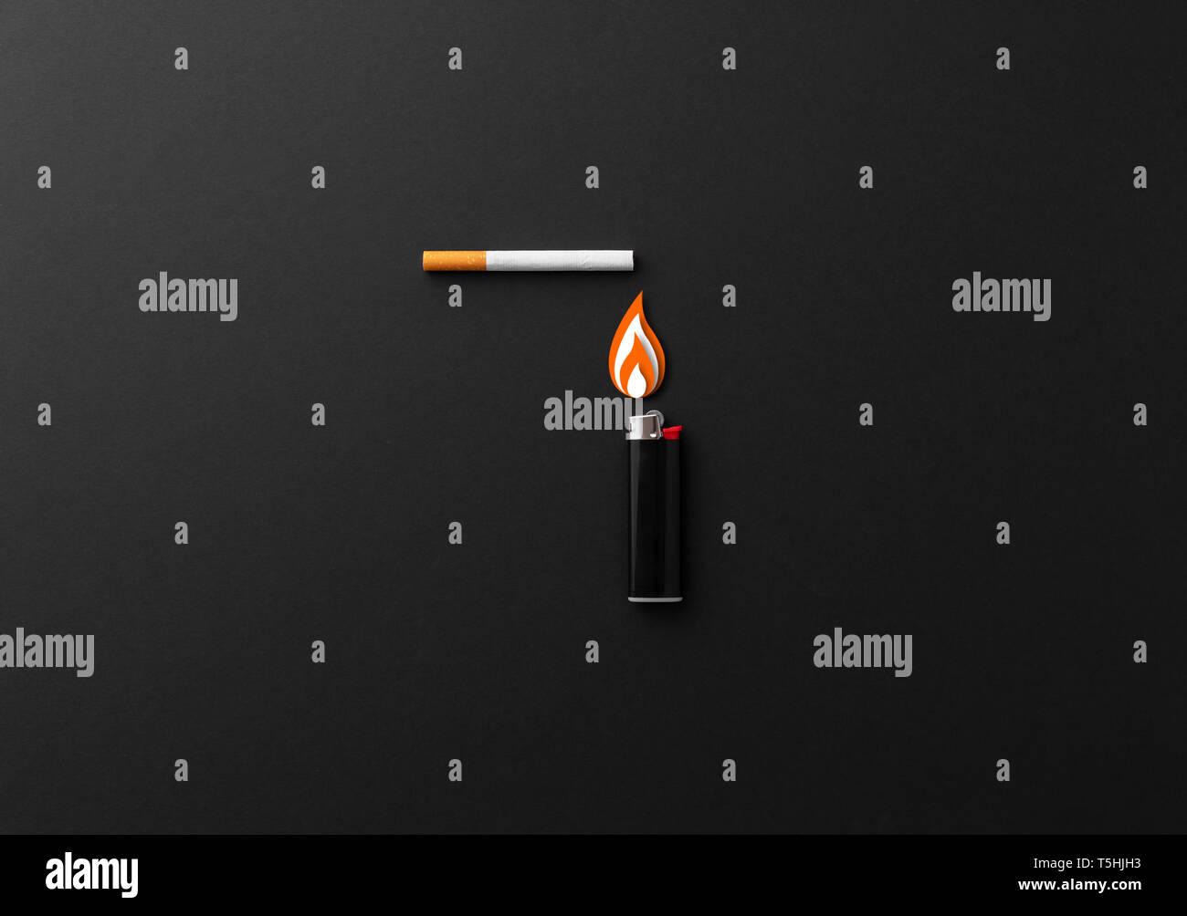 Lighting a cigarette concept over black background Stock Photo