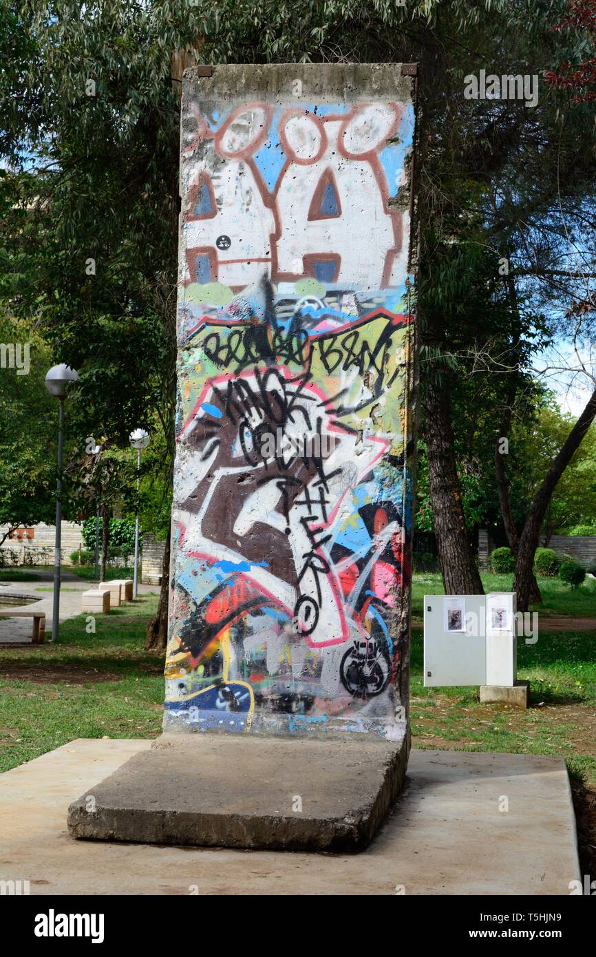 Graffiti on a fragment of the Berlin Wall built in 1961 and demolished in 1990  a gift to the people of Albania from the city of Berlin Tirana Albania - Stock Image