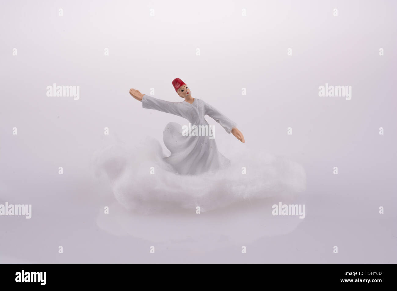 Sufi Derviş on a Cloud on a white background - Stock Image