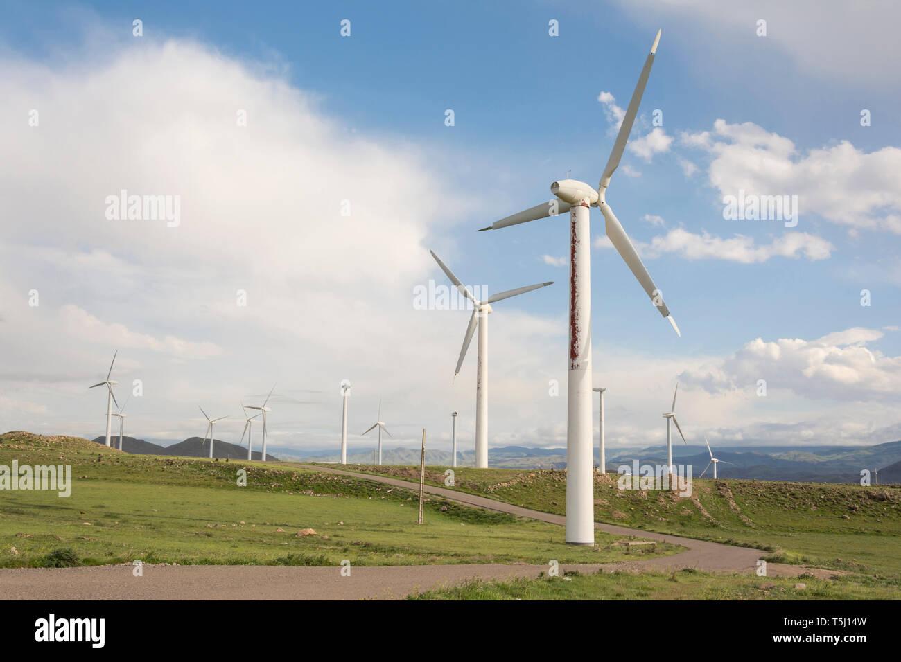 Windmills farm, modern power generation technology, environmentally friendly electricity production - Stock Image