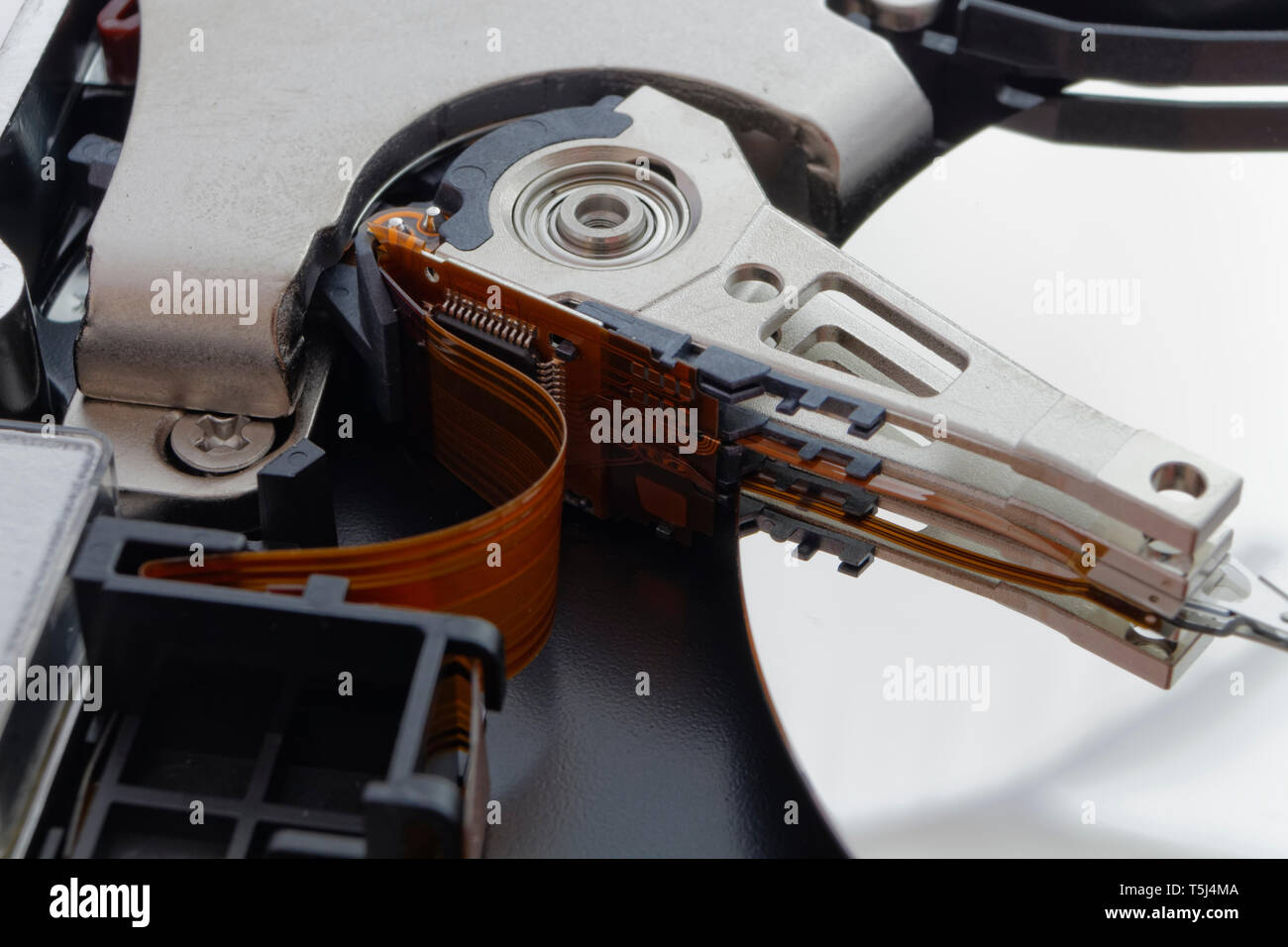 The internal detail of a computer hard drive hdd, inside view of data storage device Stock Photo