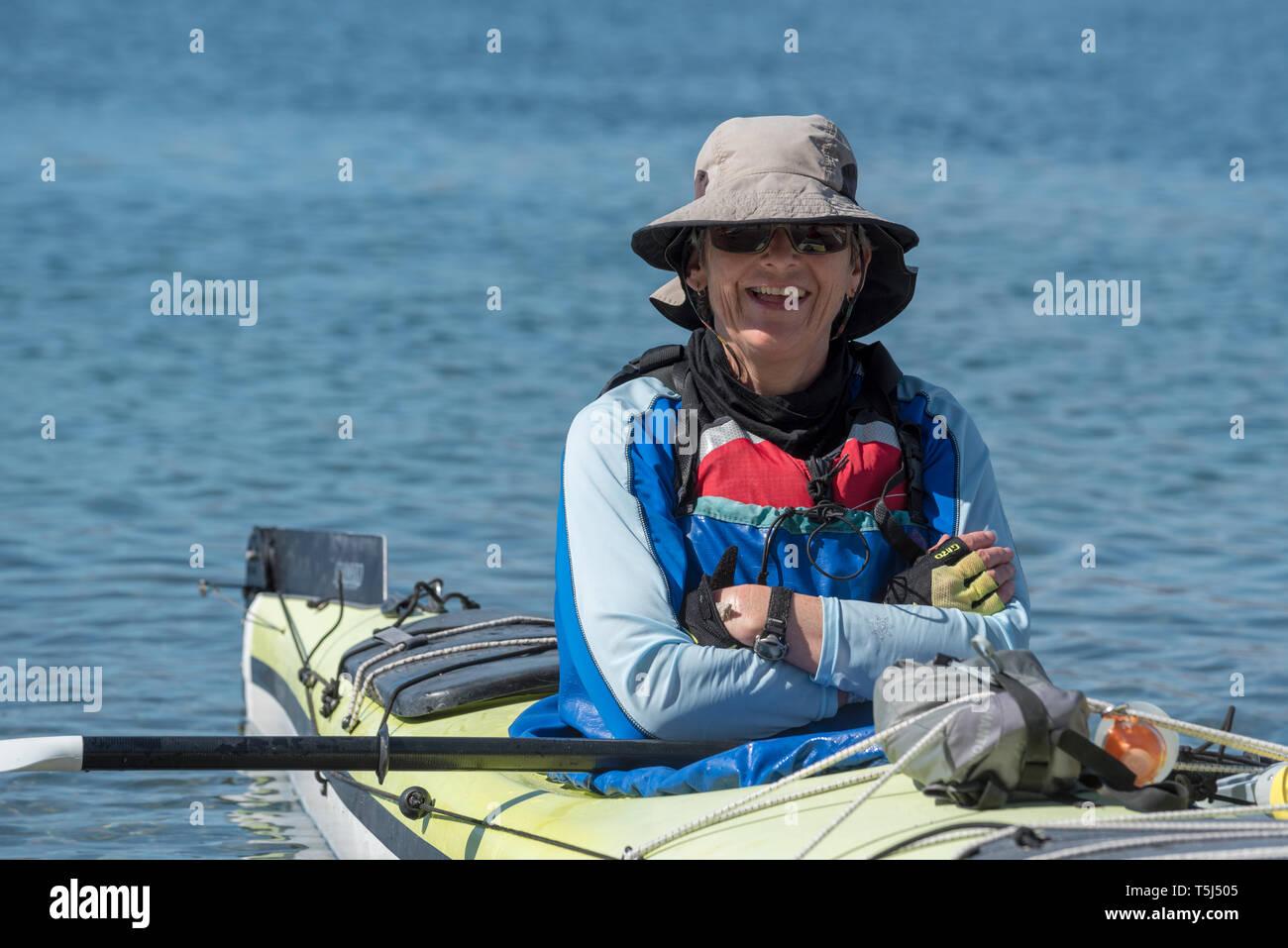 Woman sea kayaking in Bay of Loreto Nat. Park, Baja California Sur, Mexico. Stock Photo