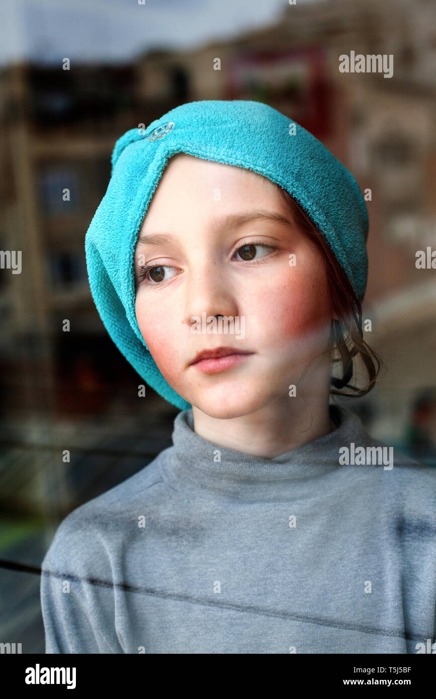 Boy looking out the window. - Stock Image