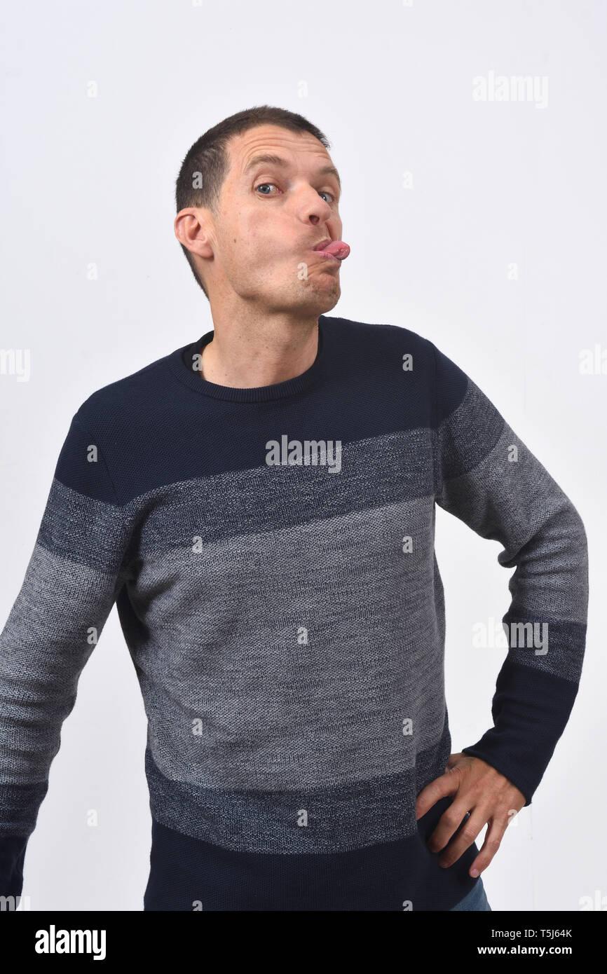man grimacing on white background - Stock Image