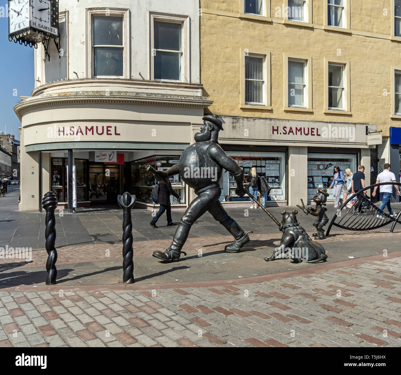 Desperate Dan bronze statue based on the character in british comic magazine The Dandy located in High Street at the City Square Dundee Scotland UK - Stock Image