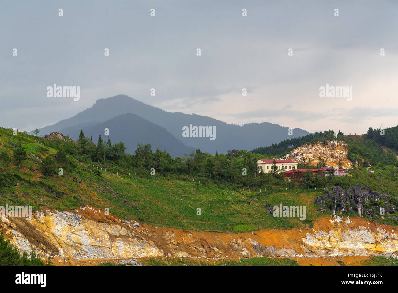 Lone building on the top of a rocky hill in SaPa, Vietnam, Asia - Stock Image
