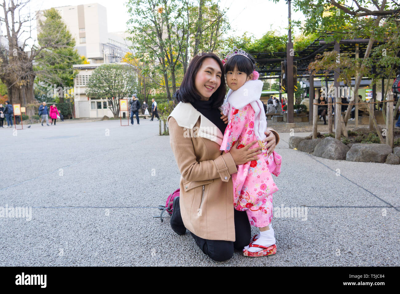 Irene Hug a Japanese Little Girl - Stock Image