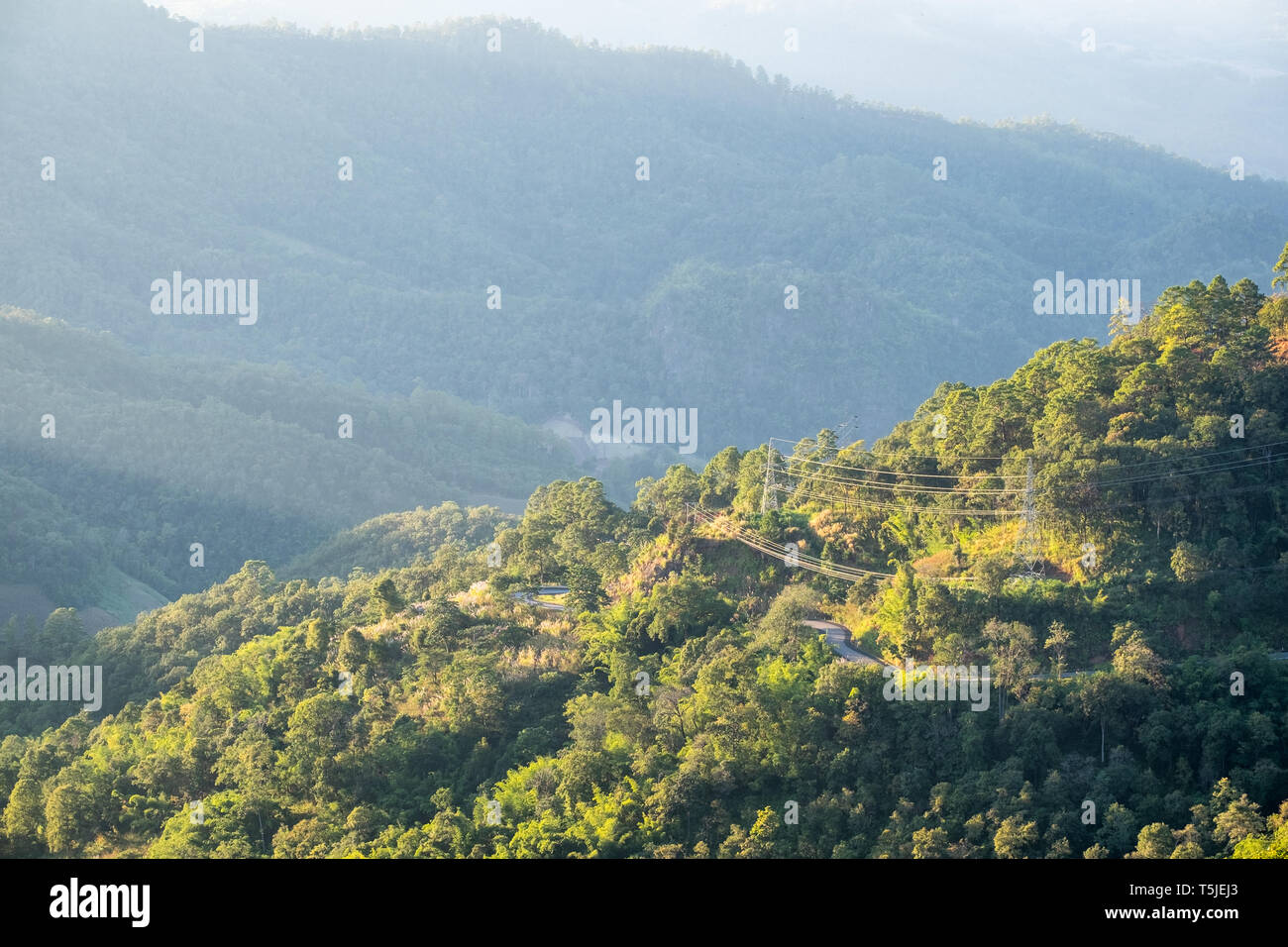Road rural in valley at evening,doi kiew lom,mae hong son,thailand - Stock Image
