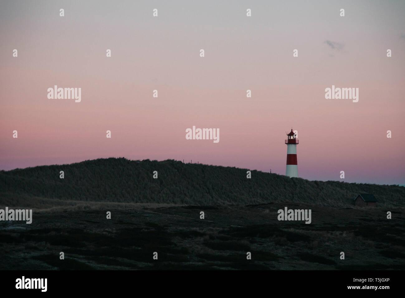 Germany, Sylt, Schleswig Holstein Wadden Sea National Park, dune landscape, Ellenbogen, lighthouse List Ost, evening light - Stock Image