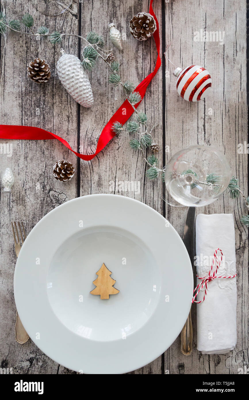 Laid table with Christmas decoration - Stock Image