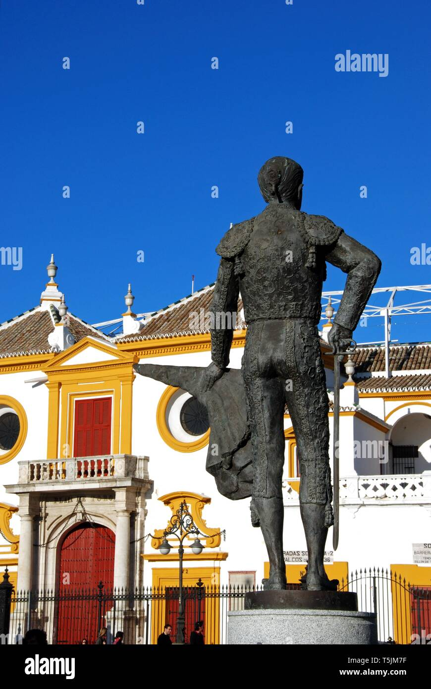 View of the bullring with a matador statue in the foreground, Seville, Seville Province, Andalusia, Spain, Europe - Stock Image