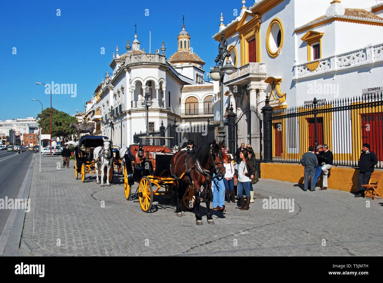 SEVILLE, SPAIN - NOVEMBER 15, 2008 - View of the bullring with horse drawn carriages in the foreground, Seville, Seville Province, Andalusia, Spain, E - Stock Image
