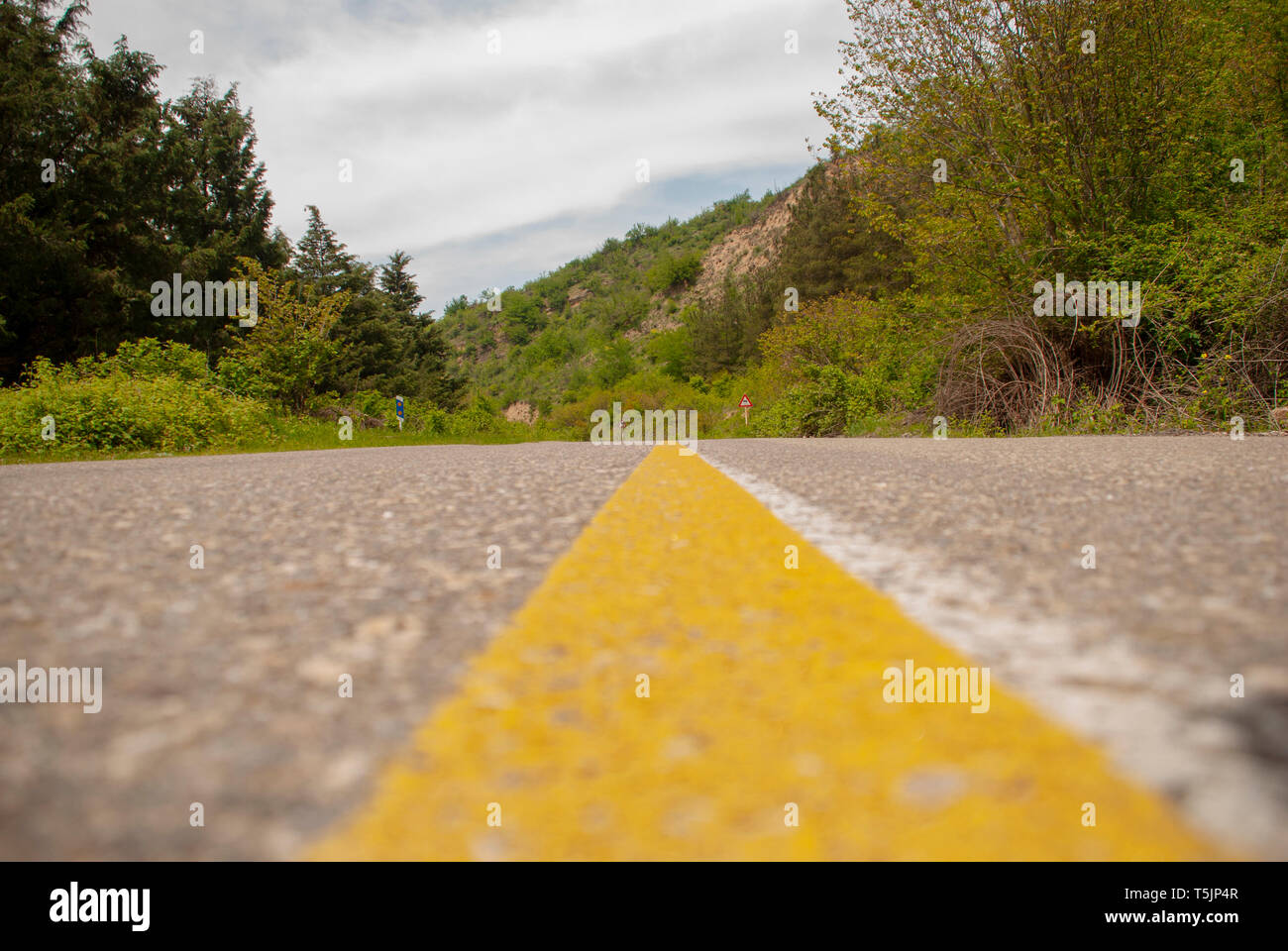 yellow line in the middle of road - Stock Image