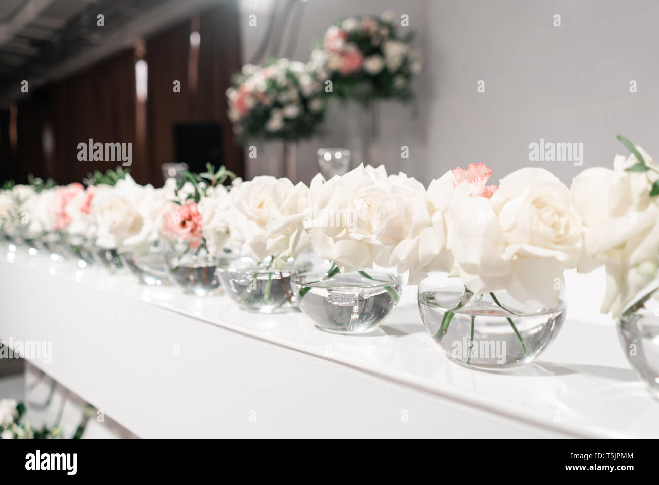 Small Flower Arrangements In Ball Glass Vases The Table Of The Newlyweds Interior Of Restaurant For Wedding Dinner Ready For Guests Catering Stock Photo Alamy