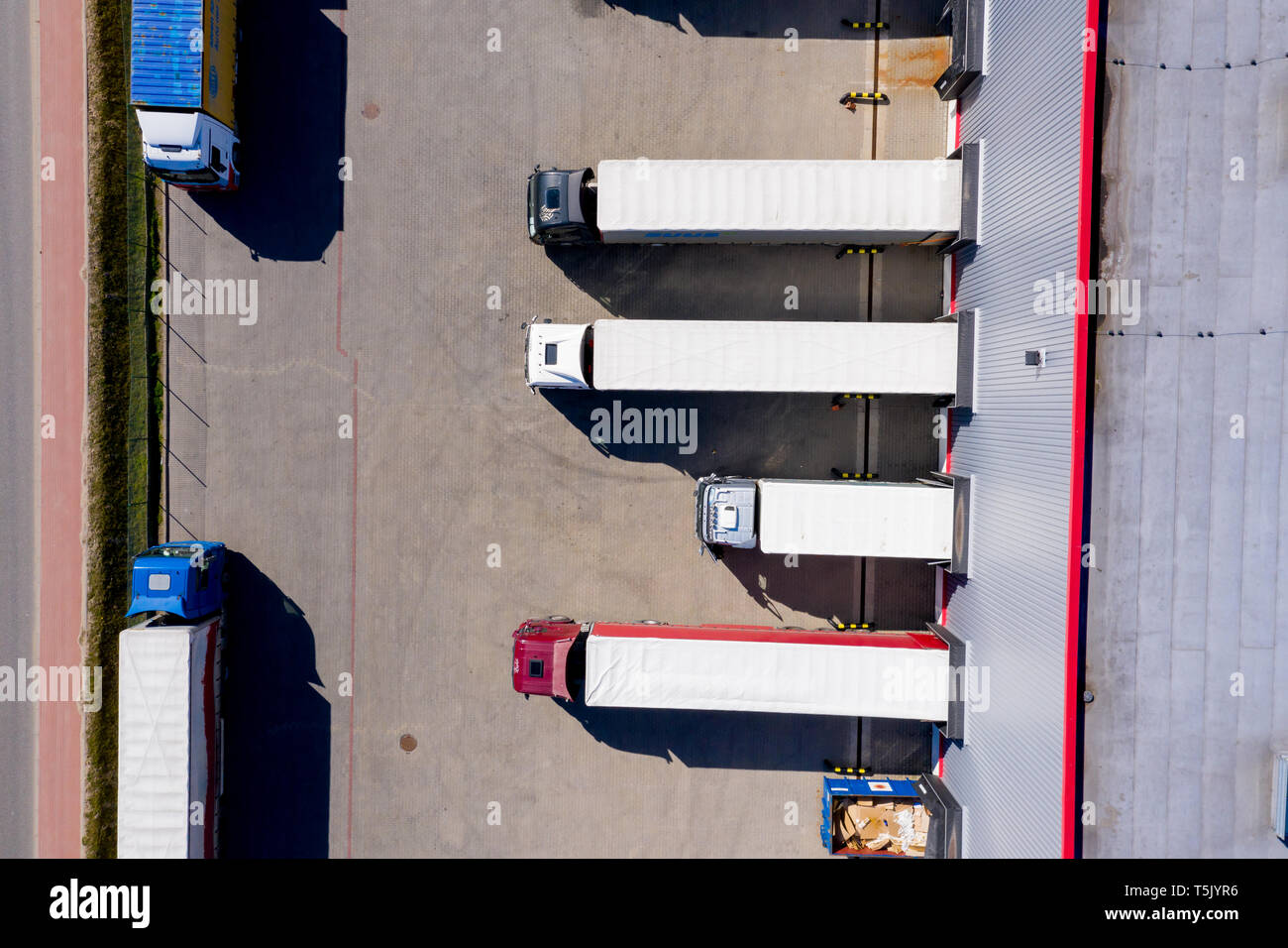 Aerial Side Shot Of Industrial Warehouse Loading Dock Where Many