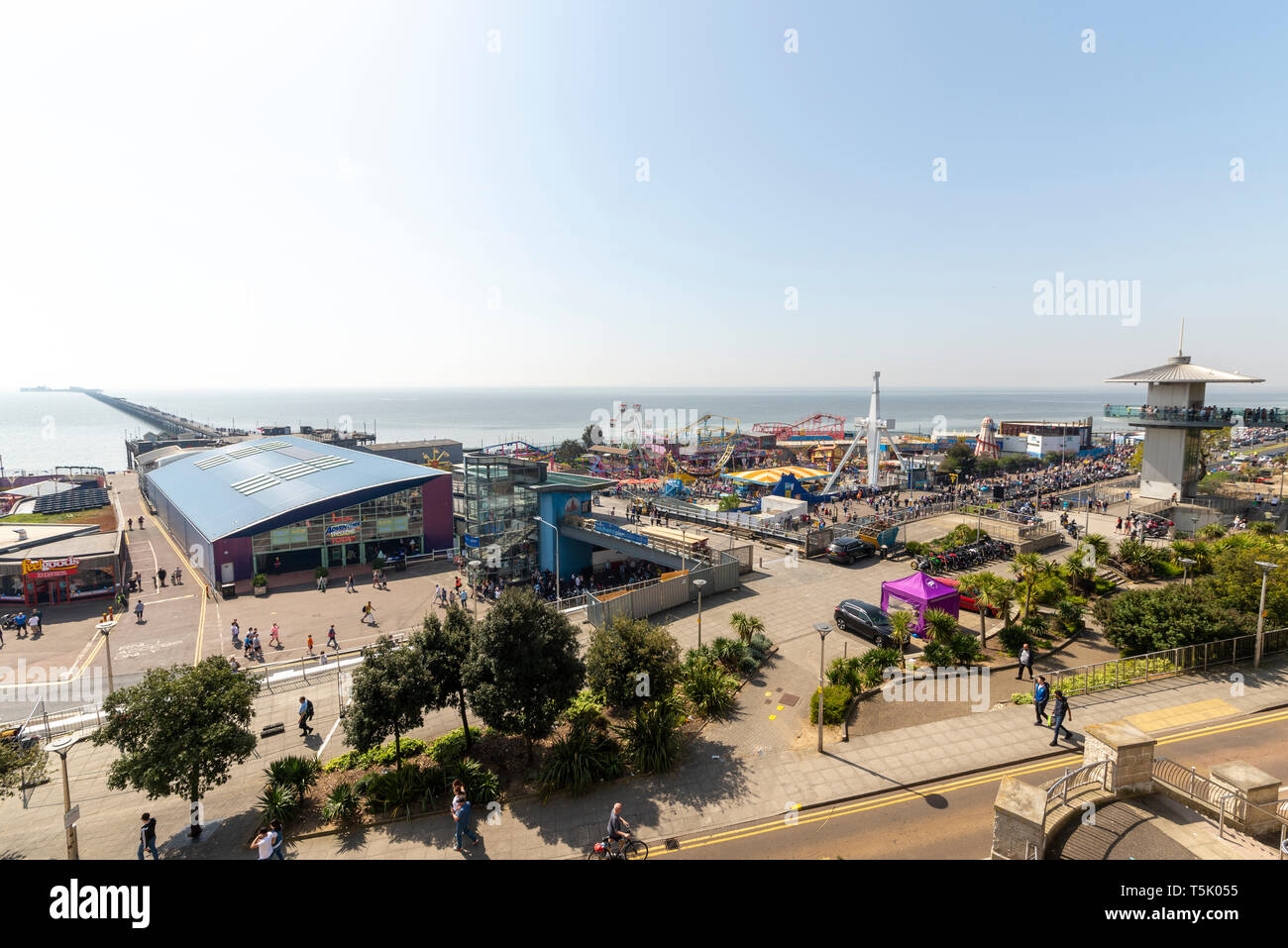 Southend on Sea, Essex, UK seafront on Easter Monday bank holiday. Adventure Island, Southend Pier, observation deck tower. Space for copy - Stock Image