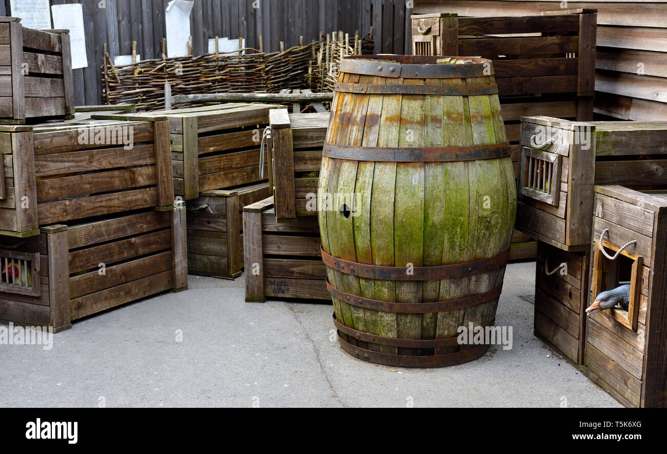 Old, antique freight shipping containers. Wooden barrel and boxes for ducks or geese Stock Photo