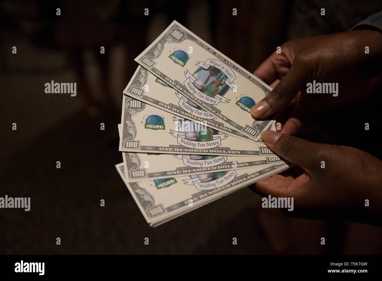 Casino money at a wedding ready to be used for a fun casino night by party goers - Stock Image
